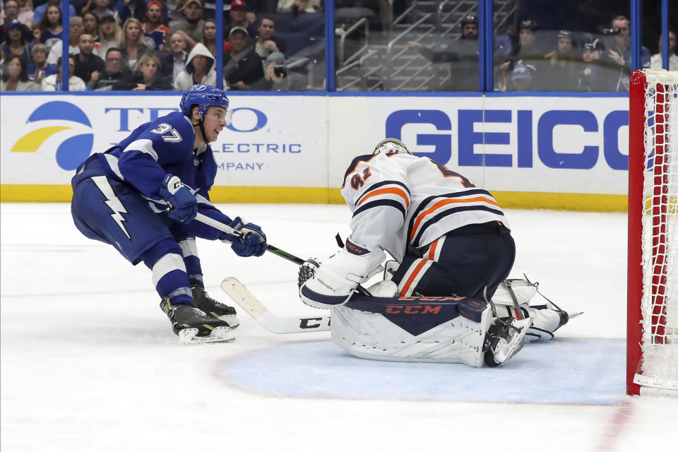 Tampa Bay Lightning's Yanni Gourde scores past Edmonton Oilers goaltender Mike Smith during the second period of an NHL hockey game Thursday, Feb. 13, 2020, in Tampa, Fla. (AP Photo/Mike Carlson)