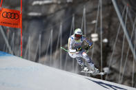 Germany's Dominik Schwaiger speeds down the course during the men's downhill, at the alpine ski World Championships in Cortina d'Ampezzo, Italy, Sunday, Feb.14, 2021. (AP Photo/Gabriele Facciotti)