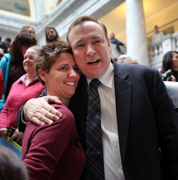 Openly gay Utah state democratic senator Jim Dabakis hugs Cathy Croft during a rally in support of gay marriage at the Utah State Capitol Friday Jan. 10, 2014 in Salt Lake City. Supporters of gay marriage fill the rotunda as they gathered to rally and deliver a petition with over 58,000 signatures in support of gay marriage to Utah Governor Gary Herbert. (AP Photo/Steve C. Wilson)