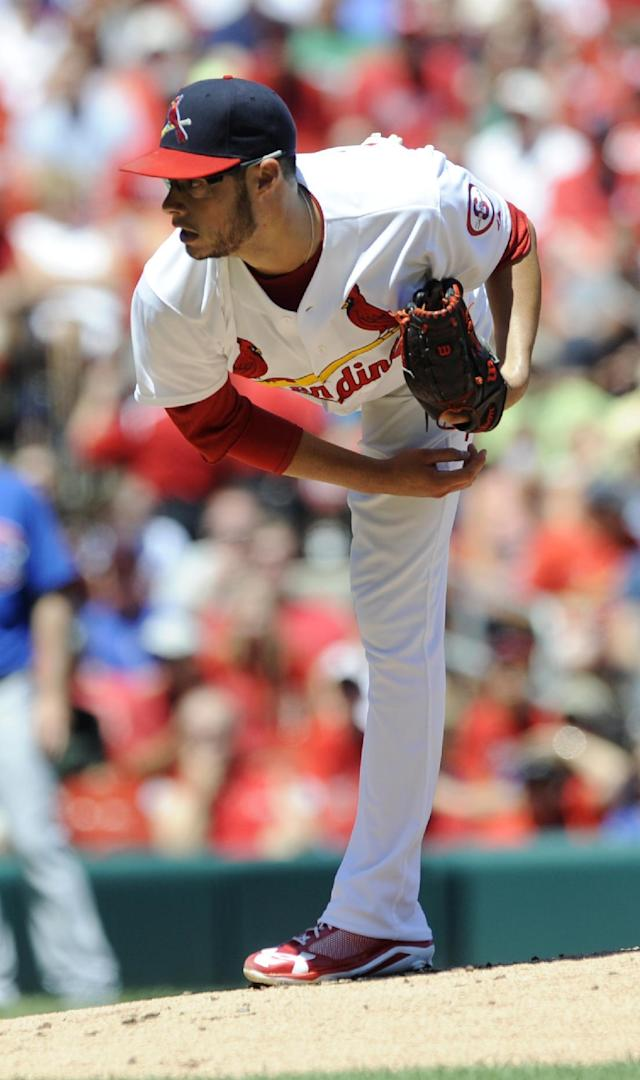 St. Louis Cardinals' starting pitcher Joe Kelly throws against Chicago Cubs in the first inning in a baseball game on Sunday, Aug. 11, 2013, at Busch Stadium in St. Louis. (AP Photo/Bill Boyce)