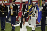 Singer Demi Lovato sings the national anthem, before the NFL Super Bowl 54 football game between the San Francisco 49ers and Kansas City Chiefs, Sunday, Feb. 2, 2020, in Miami Gardens, Fla. (AP Photo/Charlie Riedel)