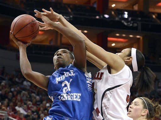 Middle Tennessee's Ebony Rowe, right, puts a shot up over the defense of Louisville's Sherrone Vails during the first half of a first-round game in the women's NCAA college basketball tournament in Louisville, Ky., Sunday, March 24, 2013. Louisville defeated Middle Tennessee 74-49. (AP Photo/Timothy D. Easley)