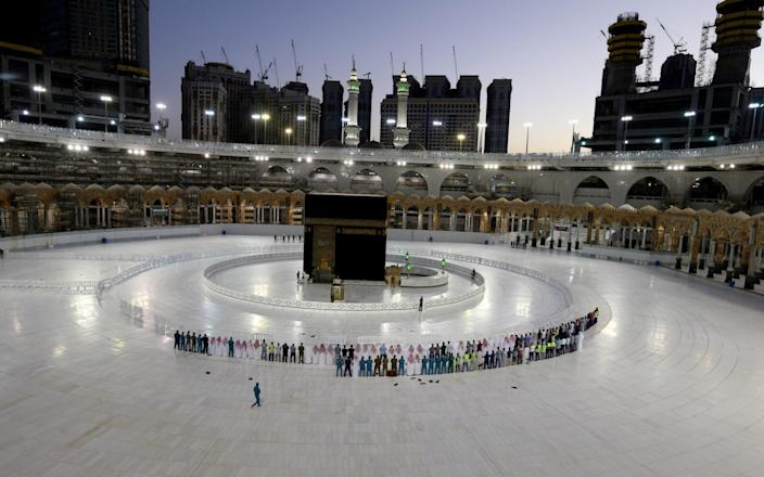 Worshippers perform Taraweeh prayer at Kaaba in the Grand Mosque on the first day of the holy month of Ramadan during the outbreak of the coronavirus - Reuters