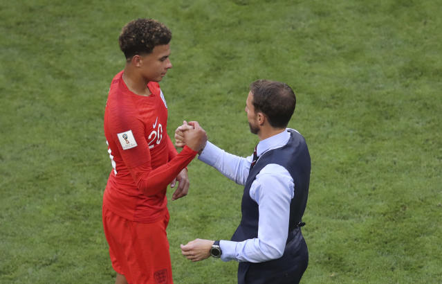 <p>England head coach Gareth Southgate shakes hands with England's Dele Alli after he was substituted </p>