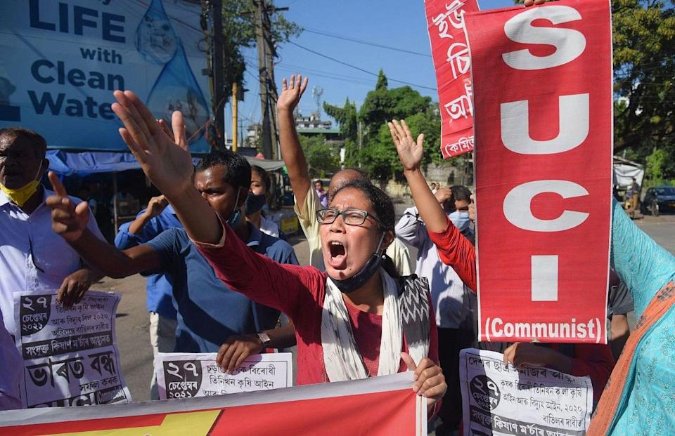 """<div class=""""paragraphs""""><p>Guwahati: Activists of Socialist Unity Centre of India (SUCI) take out a protest rally to support farmers Bharat Bandh strike against central governments three farm reform laws.</p></div>"""