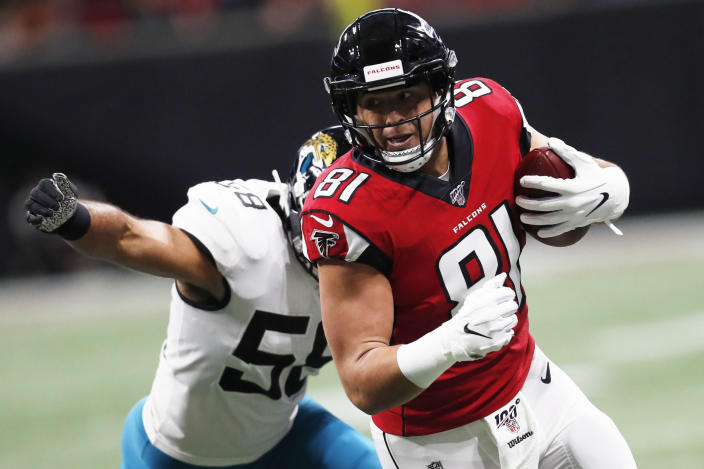 Atlanta Falcons tight end Austin Hooper (81) runs against Jacksonville Jaguars linebacker Austin Calitro (58) during the first half of an NFL football game, Sunday, Dec. 22, 2019, in Atlanta. (AP Photo/John Bazemore)