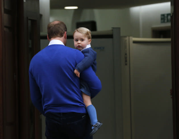 Britain's Prince William returns with his son George to the Lindo Wing of St Mary's Hospital, after the birth of his daughter in London, Britain May 2, 2015.