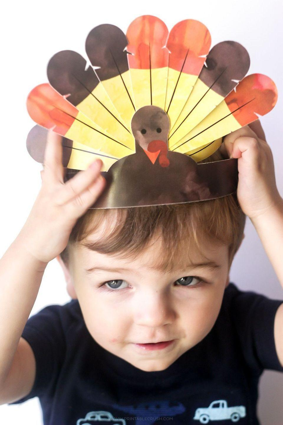 """<p>There are two wonderful things to know about these turkey crowns: For starters, they're offered as a free printable, and they come with easy-to-follow instructions. But the best part of all is that your kids can wear them all dinner long.</p><p><strong>Get the tutorial at <a href=""""https://printablecrush.com/free-printable-thanksgiving-turkey-crowns/"""" rel=""""nofollow noopener"""" target=""""_blank"""" data-ylk=""""slk:Printable Crush"""" class=""""link rapid-noclick-resp"""">Printable Crush</a>.</strong></p><p><strong><a class=""""link rapid-noclick-resp"""" href=""""https://www.amazon.com/Inches-Letter-Sheets-Smooth-216gsm/dp/B00RU6IGAS?tag=syn-yahoo-20&ascsubtag=%5Bartid%7C10050.g.28638625%5Bsrc%7Cyahoo-us"""" rel=""""nofollow noopener"""" target=""""_blank"""" data-ylk=""""slk:SHOP CARD STOCK"""">SHOP CARD STOCK</a></strong></p>"""