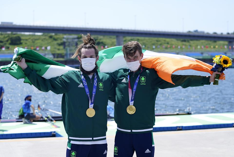 Ireland's Paul O'Donovan and Fintan McCarthy with their gold medals after winning the lightweight double sculls (Danny Lawson/PA) (PA Wire)