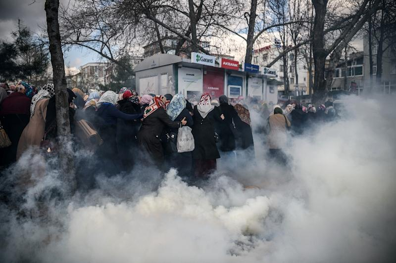 A group of women appear engulfed in smoke as tear gas is used to disperse the crowds outside the Zaman headquarters in Istanbul on March 5, 2016 (AFP Photo/Ozan Kose)