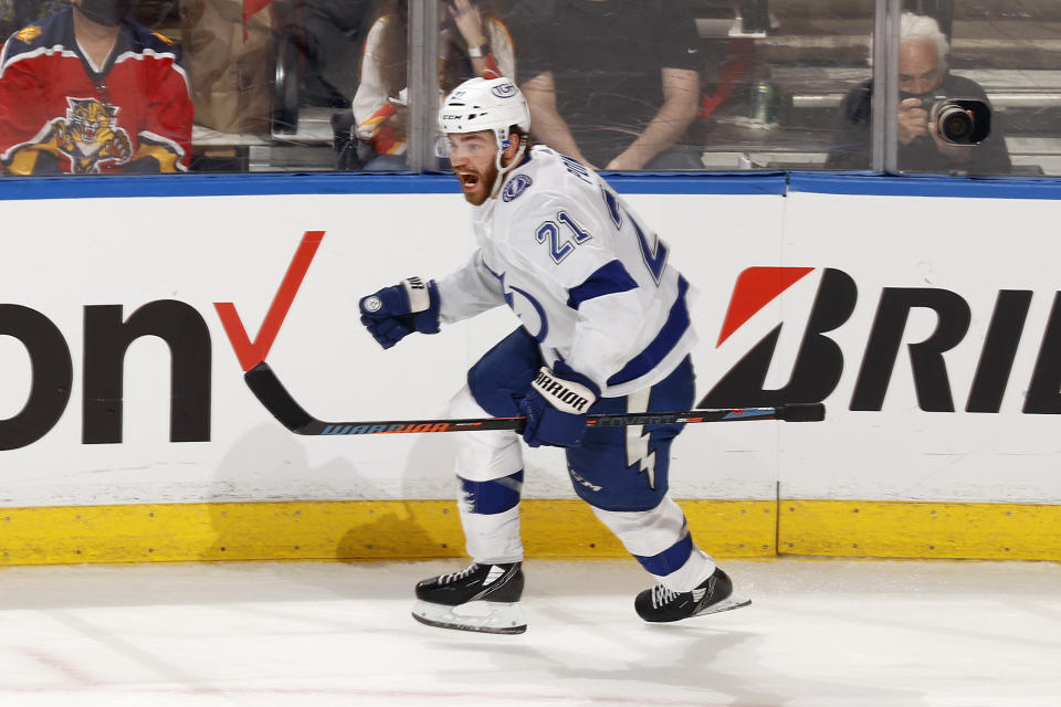 Tampa Bay Lightning defenseman Brayden Point (21) celebrates after scoring the game winning goal against the Florida Panthers during the third period in Game 1 of an NHL hockey Stanley Cup first-round playoff series, Sunday, May 16, 2021, in Sunrise, Fla. (AP Photo/Joel Auerbach)