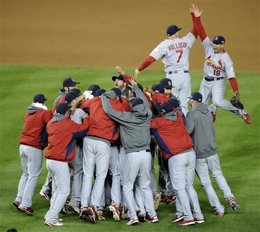 Members of the St. Louis Cardinals celebrate after Game 5 of the National League division baseball series against the Washington Nationals on Saturday, Oct 13, 2012, in Washington. St. Louis won 9-7. (AP Photo/Nick Wass)