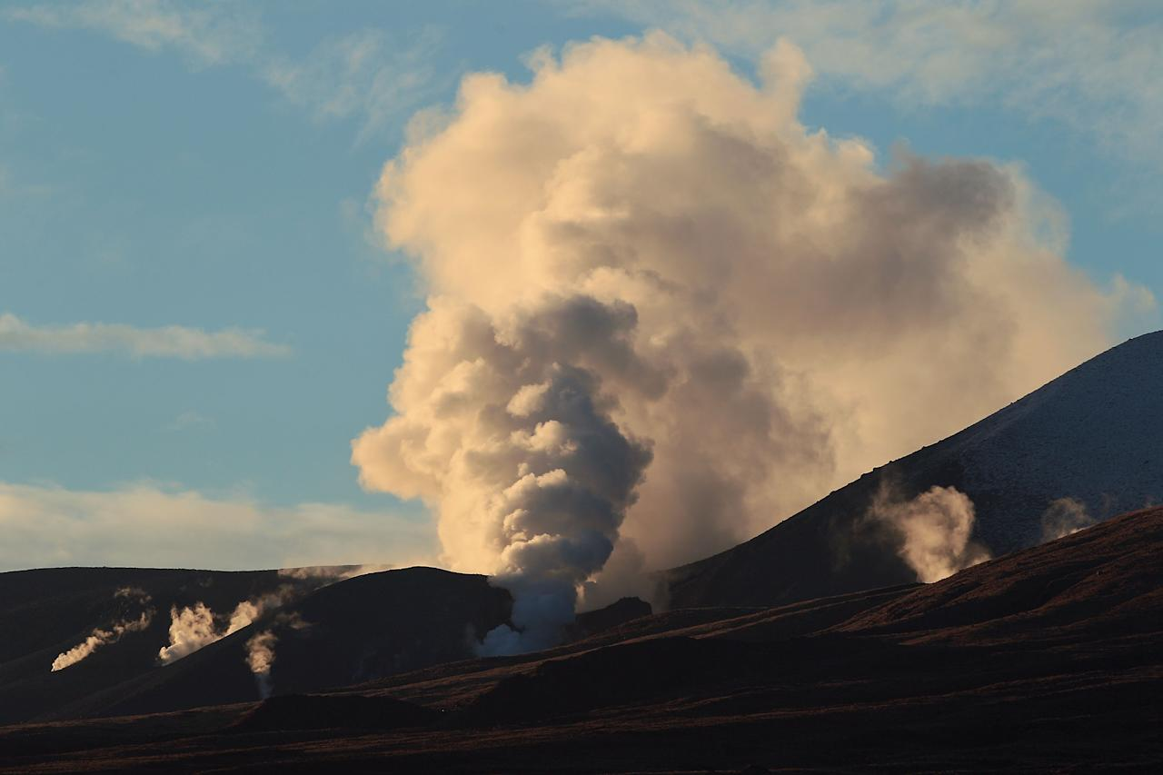TONGARIRO NATIONAL PARK, NEW ZEALAND - AUGUST 08: Steam spills from Mt Tongariro after the mountain erupted for the first time in over 100 years on August 8, 2012 in Tongariro National Park, New Zealand. Mt Tongariro erupted intermittently from 1855 to 1897. Although not an immediate threat to the community, the latest eruption may be the beginning of weeks, months or even years of volcanic activity. (Photo by Hagen Hopkins/Getty Images)
