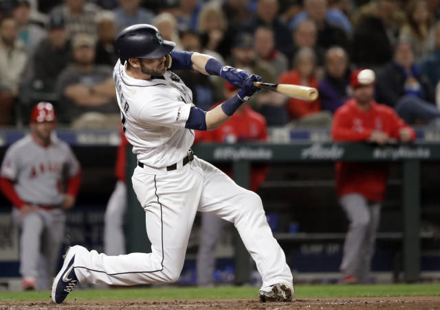 Seattle Mariners' Mitch Haniger doubles in a run against the Los Angeles Angels in the sixth inning of a baseball game Tuesday, April 2, 2019, in Seattle. (AP Photo/Elaine Thompson)