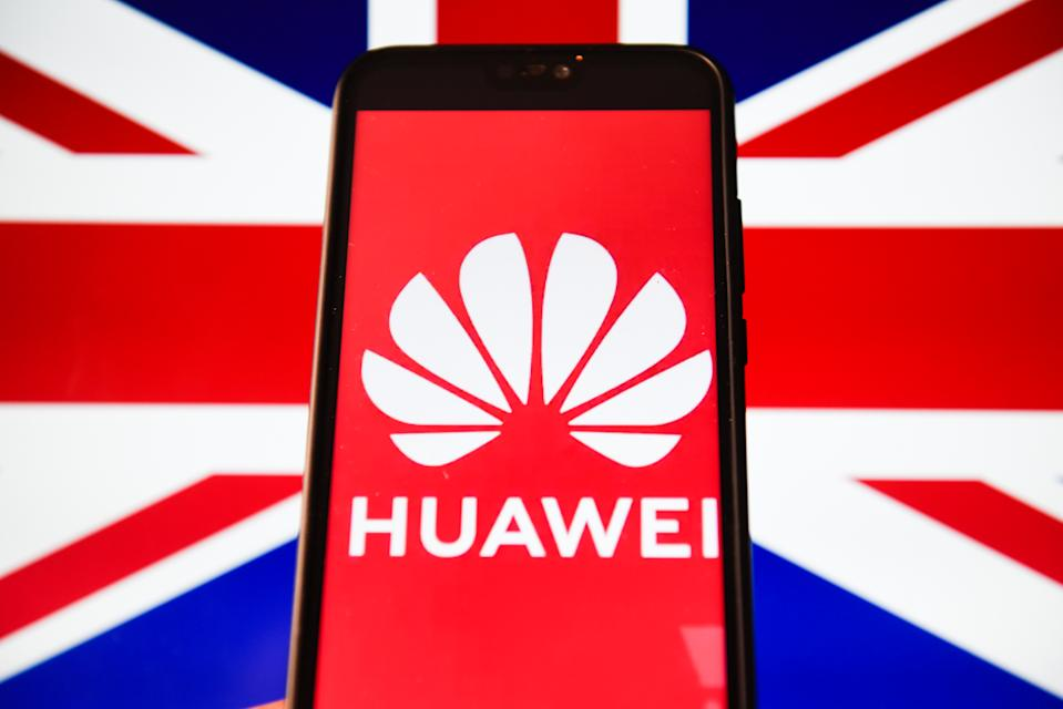 In this photo illustration a Huawei logo seen displayed on a smart phone with United Kingdom flag displayed on a laptop screen. Photo: Omar Marques/SOPA Images/LightRocket via Getty Images