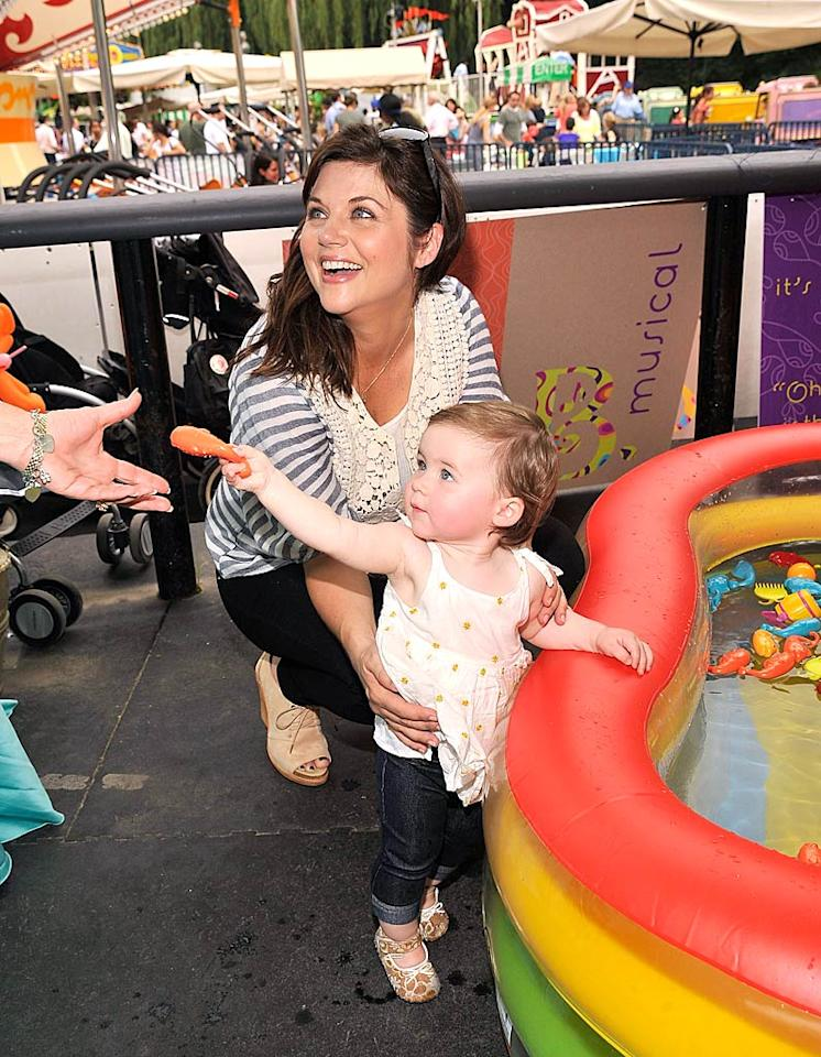"""Actress Tiffani Thiessen and her nearly 1-year-old daughter, Harper Renn Smith, had a blast at the 10th Anniversary Baby Buggy Bedtime Bash. Jessica and Jerry Seinfeld hosted the event, which raises money for families in need, at Wollman Rink in New York's Central Park. Gary Gershoff/<a href=""""http://www.wireimage.com"""" target=""""new"""">WireImage.com</a> - June 1, 2011"""