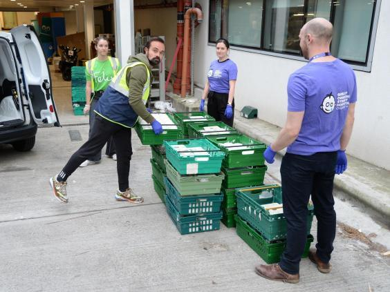 Helping hand: Evgeny Lebedev delivers 600 meals to Great Ormond Street staff with other Felix volunteers (Hannah Harley Young)