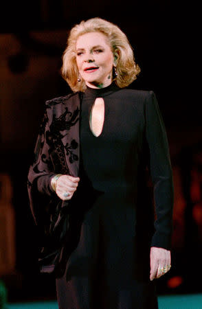 Hollywood actress Lauren Bacall models for Gai Mattiolo's Autumn-Winter '98 haute couture collection in Rome, in this file picture taken July 13, 1997. REUTERS/Stringer
