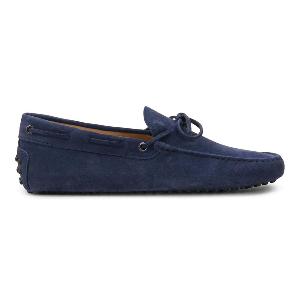 """<p><strong>Tod's</strong></p><p>tods.com</p><p><strong>$545.00</strong></p><p><a href=""""https://go.redirectingat.com?id=74968X1596630&url=https%3A%2F%2Fwww.tods.com%2Fus-en%2Fp%2FXXM0GW05470RE0U820&sref=https%3A%2F%2Fwww.esquire.com%2Flifestyle%2Fg23013003%2Fbest-gifts-for-husband-ideas%2F"""" rel=""""nofollow noopener"""" target=""""_blank"""" data-ylk=""""slk:Buy"""" class=""""link rapid-noclick-resp"""">Buy</a></p><p>There is perhaps no shoe that says """"I'm going to kick back and enjoy the hell out of this perfect fall day"""" more effectively than Tod's signature Gommino. And doesn't he deserve to kick back? </p>"""