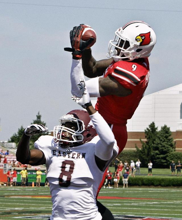 Louisville wide receiver DeVante Parker (9) makes this 19-yard pass reception in the end zone over Eastern Kentucky defender Johnny Joseph (8) in the first quarter of a NCAA college football game in Louisville, Ky., Saturday, Sept. 7, 2013. (AP Photo/Garry Jones)