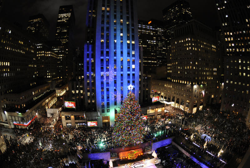 The Rockefeller Christmas tree, a 12-ton, 74-foot Norway spruce covered in 30,000 energy efficient LED lights, is lit in Rockefeller Center in New York, Tuesday, Nov. 30, 2010. (AP Photo/Henny Ray Abrams)