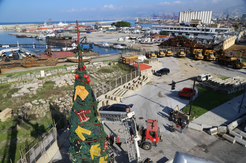 A Christmas tree made by Lebanese artist Hayat Nazer and decorated with uniforms of firefighters and rescuers as a way to pay tribute to those who died at Beirut port explosion, is seen in Beirut