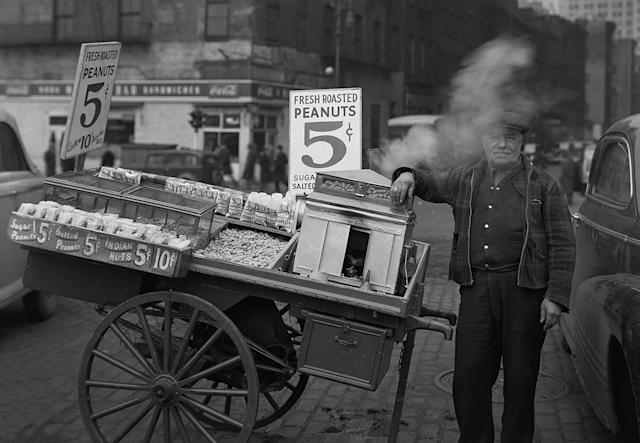 <p>Peanut man, the Battery, New York, 1946. (© Todd Webb Archive) </p>