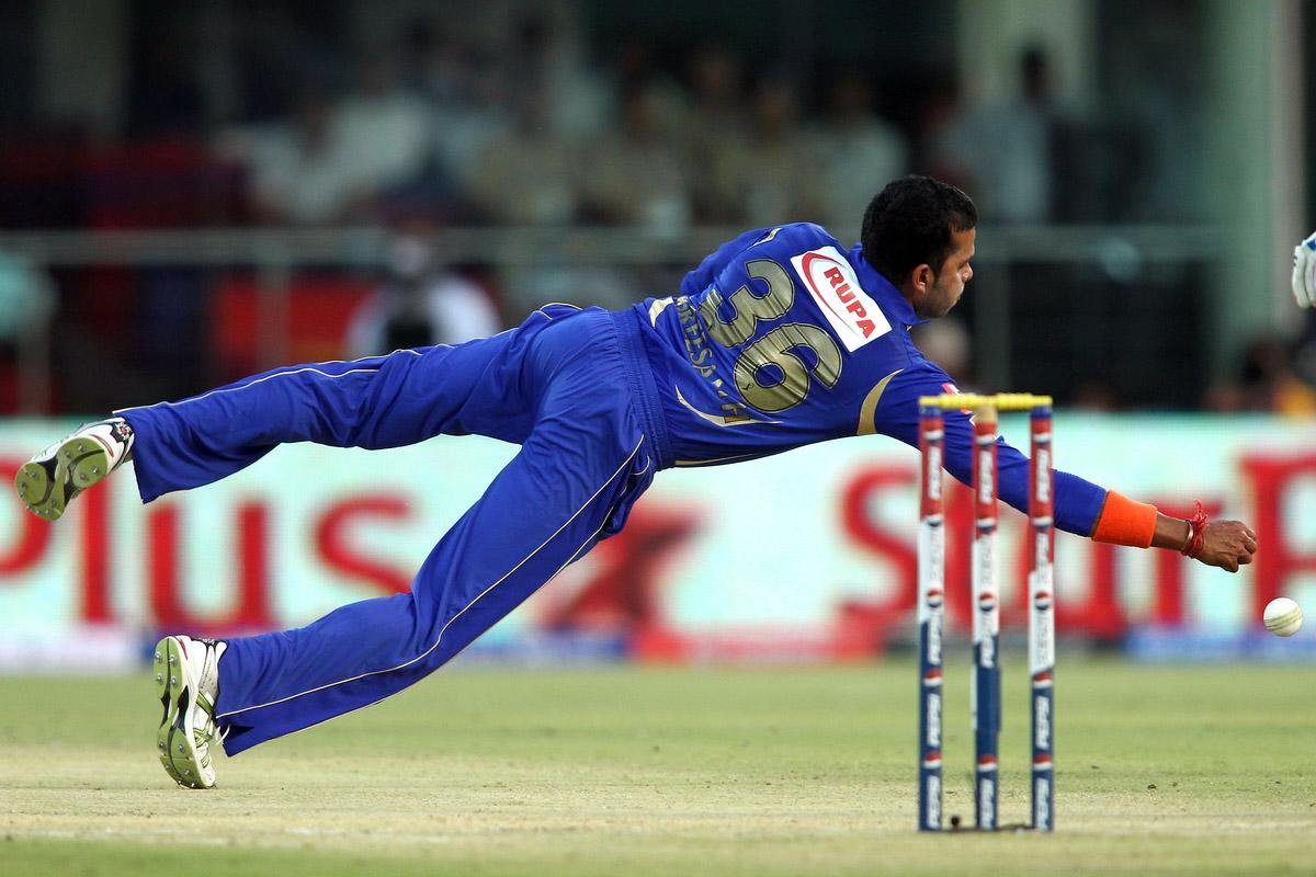 Sree Sreesanth of Rajasthan Royals dives to make a stop off his own bowling during match 4 of the Pepsi Indian Premier League between Delhi Daredevils and the Rajasthan Royals held at the Feroz Shah Kotla Stadium, Delhi on the 6th April 2013..Photo by Shaun Roy-IPL-SPORTZPICS ..Use of this image is subject to the terms and conditions as outlined by the BCCI. These terms can be found by following this link:..https://ec.yimg.com/ec?url=http%3a%2f%2fwww.sportzpics.co.za%2fimage%2fI0000SoRagM2cIEc&t=1490450399&sig=aYcCJ4igpYWbZGyFO0fx0Q--~C
