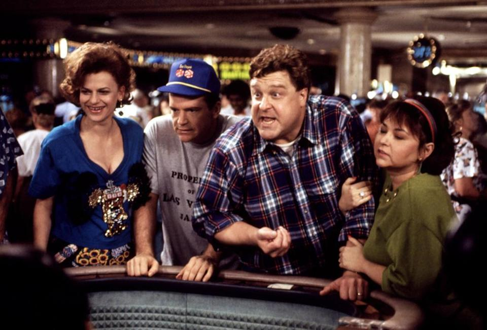 """<p><strong>""""Vegas Vegas"""" (1991)</strong><br><br>In Season 4, Roseanne and Dan ditched the kids to head to a quickie Vegas vacation, but the Conners clashed over the craps table. Still, they got to hobnob with Wayne Newton and renew their wedding vows in a Vegas chapel, so this trip was definitely worth the gamble.<br><br>(Photo: Everett Collection) </p>"""