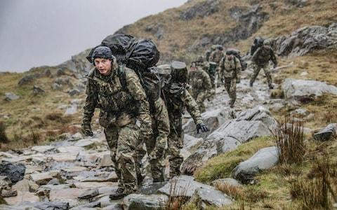 "The report says that ""microaggressions"" can be exacerbated by military culture. Image of Royal Marines attempting to reach the summit of Mount Snowden during Exercise Winter Walker in 2018. - Credit: Leading Phot Dean Nixon"