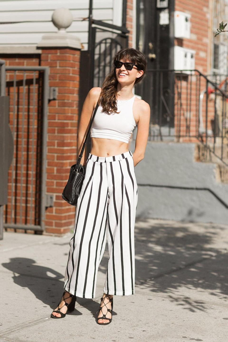 <p>Skip the matching set and pair a crop top with high-waisted pants for a cool spin on hot weather style.</p>