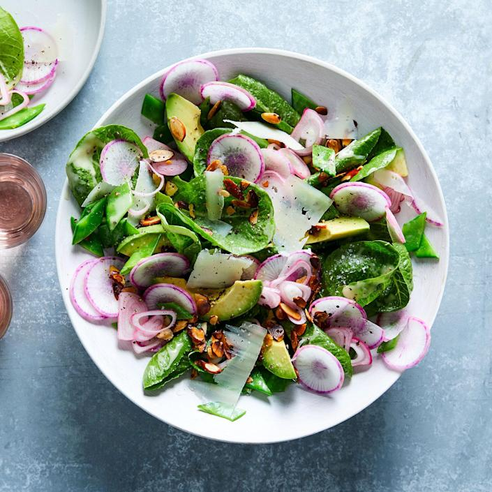 <p>Quick-pickling the shallot tames its sharpness while preserving its crunch. Instead of pouring the pickling liquid down the drain, we use it to make a flavorful vinaigrette for this spring salad.</p>