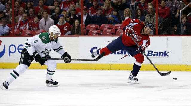 Washington Capitals left wing Jason Chimera (25) shoots as he guarded by Dallas Stars defenseman Trevor Daley (6) in the first period of an NHL hockey game, Tuesday, April 1, 2014, in Washington. (AP Photo/Alex Brandon)