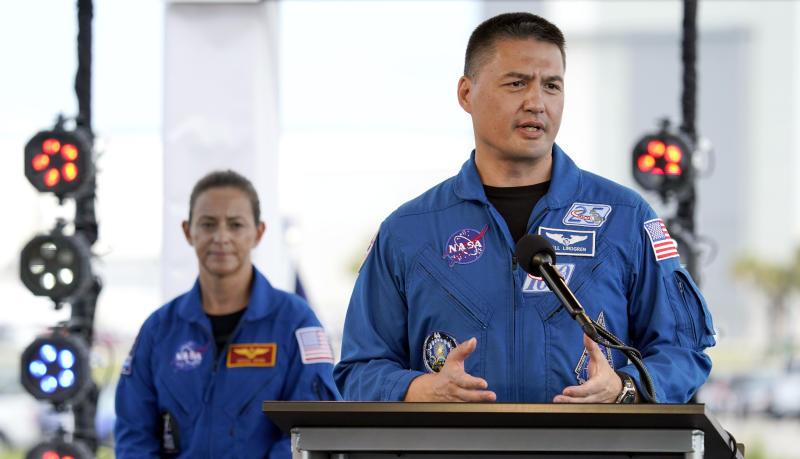 NASA astronaut Kjell Lindgren, right, answers a question during a countdown clock briefing for the SpaceX Demo-2 mission Friday, May 29, 2020, at Kennedy Space Center in Cape Canaveral, Fla. The Falcon 9, with the Crew Dragon spacecraft on top of the rocket, is scheduled to liftoff from Launch Pad 39-A Saturday. Two astronauts will fly on the mission to the International Space Station. (AP Photo/David J. Phillip)