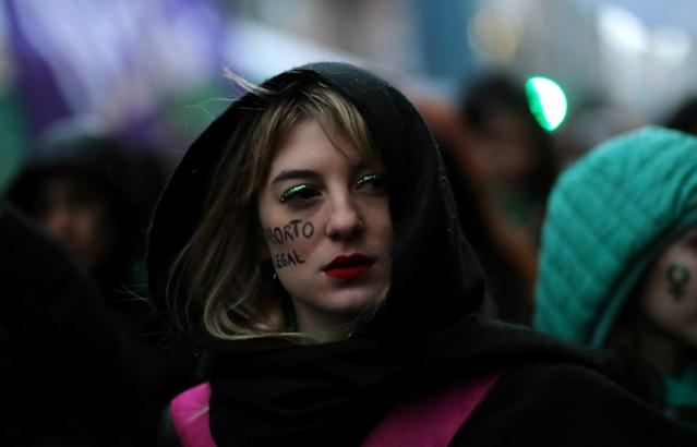 "<p>An abortion rights activist, with the words ""Legal abortion"" written on her cheek, attends a gathering as lawmakers are expected to vote on a bill legalizing abortion, in Buenos Aires, Argentina, Aug. 8, 2018. (Photo: Marcos Brindicci/Reuters) </p>"