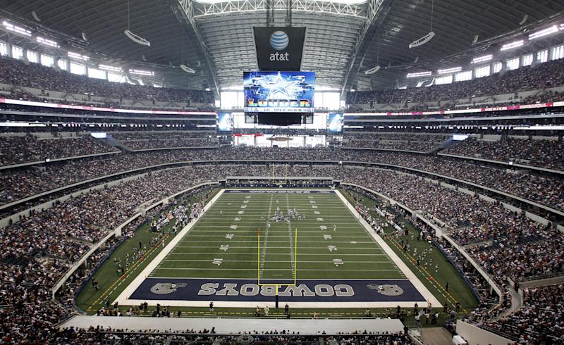 FILE - In this Oct. 23, 2011, file photo, fans cheer as the St. Louis Rams and Dallas Cowboys play in an NFL football game at Cowboys Stadium in Arlington, Texas. A person familiar with the decision tells The Associated Press that Arlington, Texas, has beaten out Tampa, Fla., in the bidding to be the site of the first title game in the new playoff system. The game will be Jan. 12, 2015.  (AP Photo/Sharon Ellman, File)
