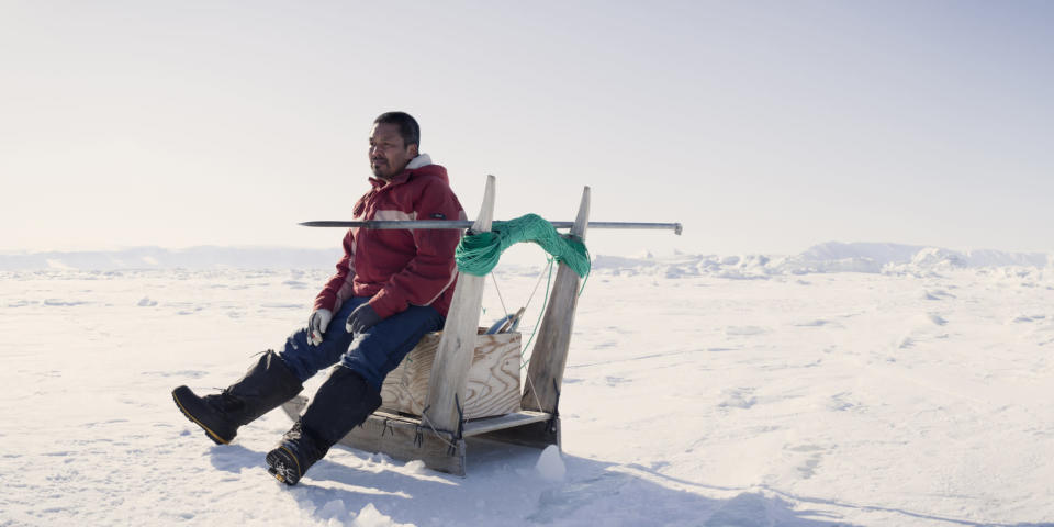 Taken in Qaanaaq, Greenland, an Inuit fisherman sits on his sled to rest while out ice fishing. (Justin Lewis. Stone. Getty Images)