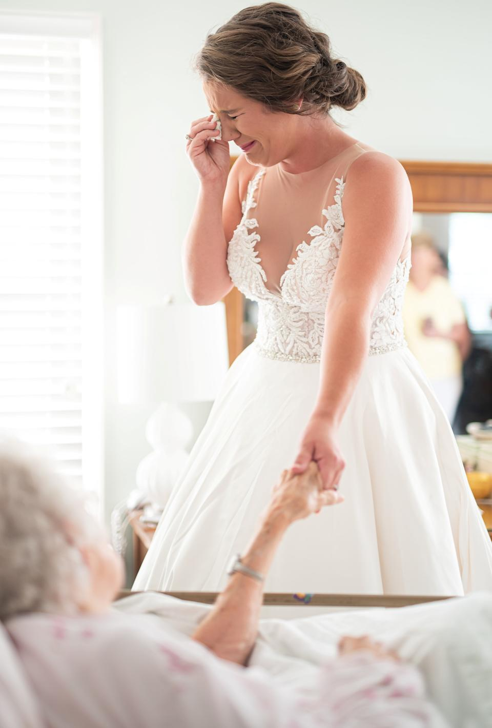 The emotional moment a dying grandmother sees her granddaughter as a bride. (SWNS)
