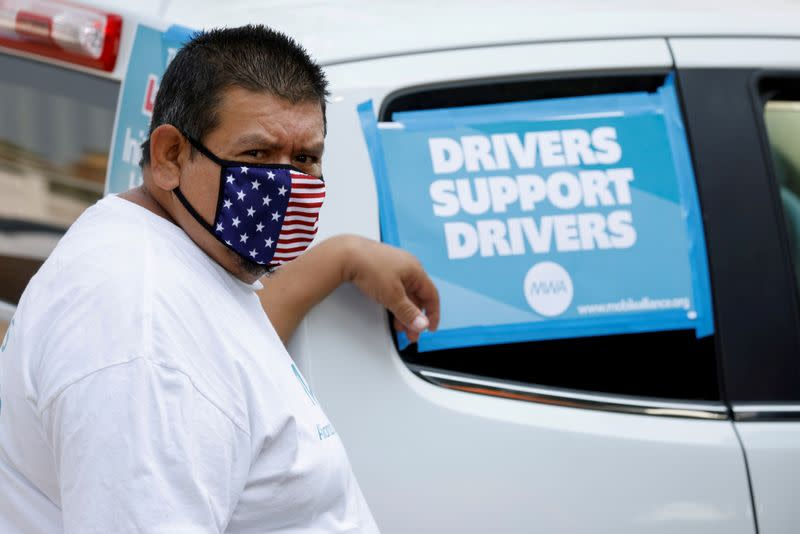 FILE PHOTO: Uber and Lyft drivers demonstrate over basic employee rights in California