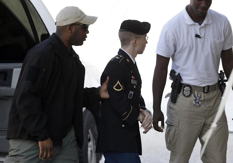 Army Pfc. Bradley Manning, center, is escorted into a courthouse in Fort Meade, Md., Tuesday, Aug. 20, 2013, before a hearing in his court martial. A prosecutor recommended in closing arguments Monday that Manning should spend 60 years in prison for giving classified material to WikiLeaks. (AP Photo/Patrick Semansky)
