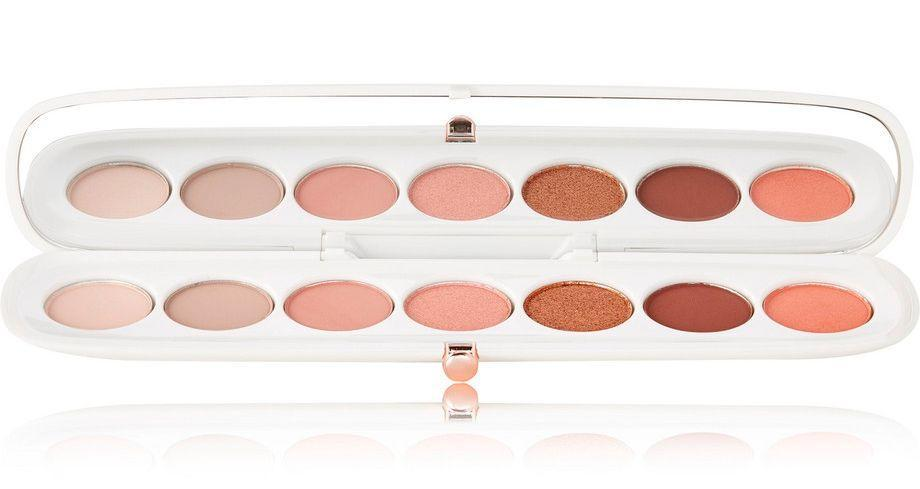 """<p>This Marc Jacobs eye palette is quite possibly the most beautiful beauty product we've ever seen. The range of pinks, peaches, coppers and rose-golds make it a dream for fans of a warm tone eye. </p><p><a class=""""link rapid-noclick-resp"""" href=""""https://go.redirectingat.com?id=127X1599956&url=https%3A%2F%2Fwww.net-a-porter.com%2Fgb%2Fen%2Fproduct%2F1069693%2FMarc_Jacobs_Beauty%2Feye-conic-longwear-eyeshadow-palette-fantascene-790&sref=http%3A%2F%2Fwww.cosmopolitan.com%2Fuk%2Fbeauty-hair%2Fg23448484%2Fnet-a-porter-beauty-products%2F"""" rel=""""nofollow noopener"""" target=""""_blank"""" data-ylk=""""slk:buy now"""">buy now</a></p>"""