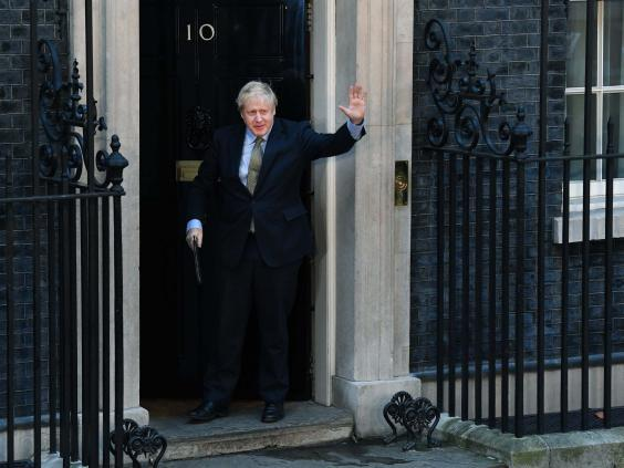 Johnson leaves No 10 to deliver a post-victory speech yesterday (EPA)