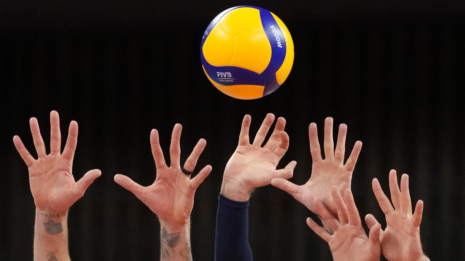 <p>United States's players reach up to block a return ball during a men's volleyball preliminary round pool B match against France, at the 2020 Summer Olympics in Tokyo, Japan. (AP Photo/Frank Augstein)</p>