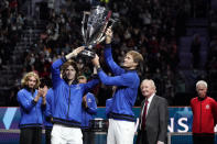 Team Europe's Andrey Rublev, left, and Alexander Zverev hold the Laver Cup aloft after they defeated Team World for tennis' Laver Cup, Sunday, Sept. 26, 2021, in Boston. Looking on, at right, is tennis great Rod Laver, and at far right, Team World captain John McEnroe. (AP Photo/Elise Amendola)
