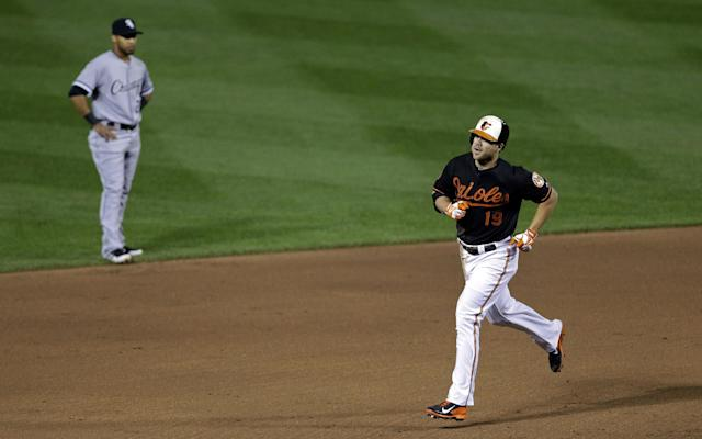 Baltimore Orioles' Chris Davis, right, rounds the bases past Chicago White Sox second baseman Leury Garcia after hitting a solo home run in the sixth inning of a baseball game on Friday, Sept. 6, 2013, in Baltimore. (AP Photo/Patrick Semansky)