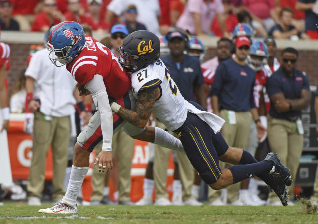 California safety Ashtyn Davis (27) tackles Mississippi quarterback Matt Corral (2) during the second half of an NCAA college football game in Oxford, Miss., Saturday, Sept. 21, 2019. California won 28-20. (AP Photo/Thomas Graning)