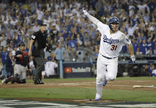 Los Angeles Dodgers' Joc Pederson celebrates after hitting a home run off of Los Angeles Dodgers pitcher Clayton Kershaw during the third inning in Game 3 of the World Series baseball game on Friday, Oct. 26, 2018, in Los Angeles. (AP Photo/David J. Phillip)