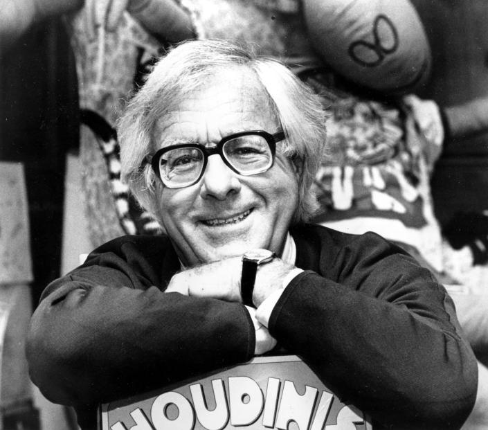Science fiction writer Ray Bradbury smiles in his Beverly Hills, Ca., office in Feb. 1982. (AP Photo/Lennox McLendon)