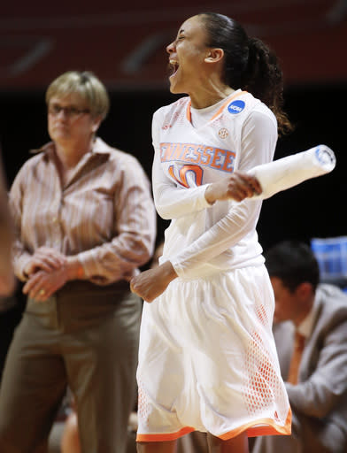 Tennessee guard Meighan Simmons (10) celebrates after a teammate scored against Northwestern State in the second half of an NCAA women's college basketball first-round tournament game, Saturday, March 22, 2014, in Knoxville, Tenn. At left is Tennessee head coach Holly Warlick. Tennessee won 70-46. (AP Photo/John Bazemore)