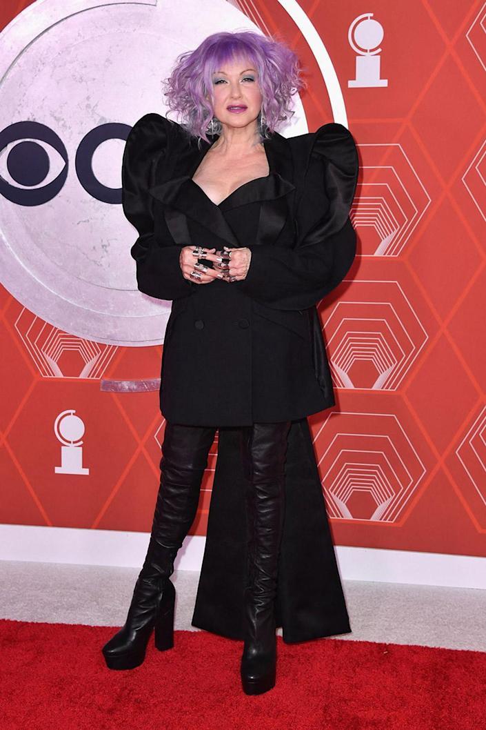 <p>Cyndi Lauper rocked purple hair and thigh-high leather platforms on the red carpet. </p>
